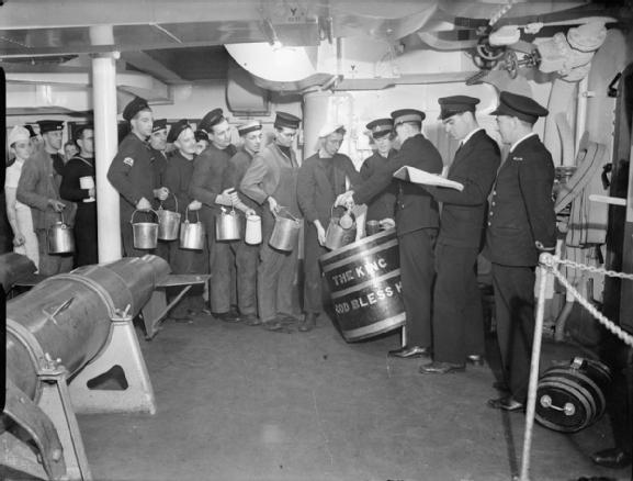 photo serving out the grog aboard unknown british warship in the 1940s, note: The King - God Bless Him