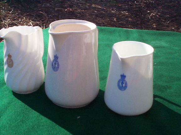 various British royal navy cream and milk pitchers ca 1950s 1960s