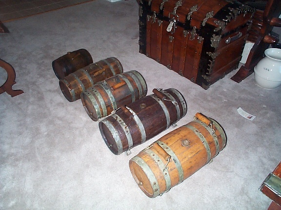 sampling and examples of different types and sizes of wooden water casks or water kegs