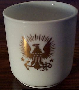 demitasse cup dated 1894 with eagle clutching anchor
