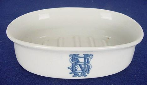 porcelain or ceramic usn soap dish with stylized USN