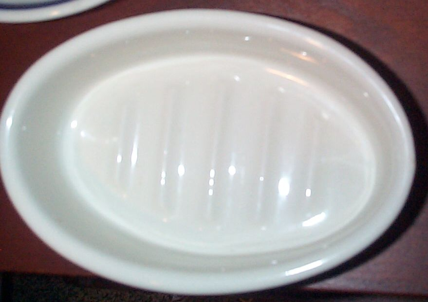 navy soap dish stamped USN, $225.