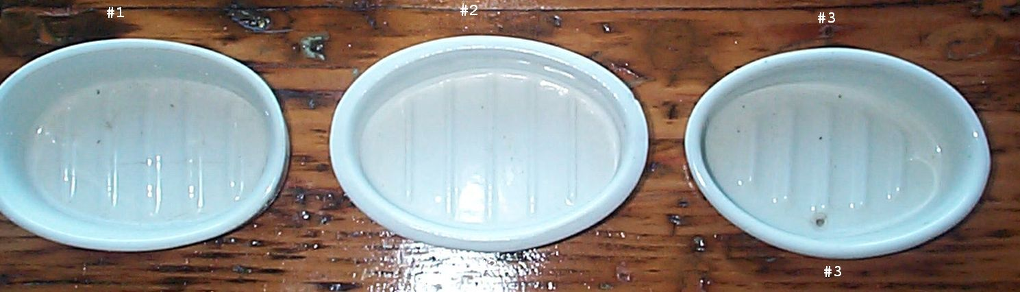 navy soap dishes stamped USN, bottom