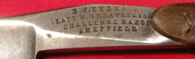 photo showing 10th century us navy straight razor stamped USN on the blade