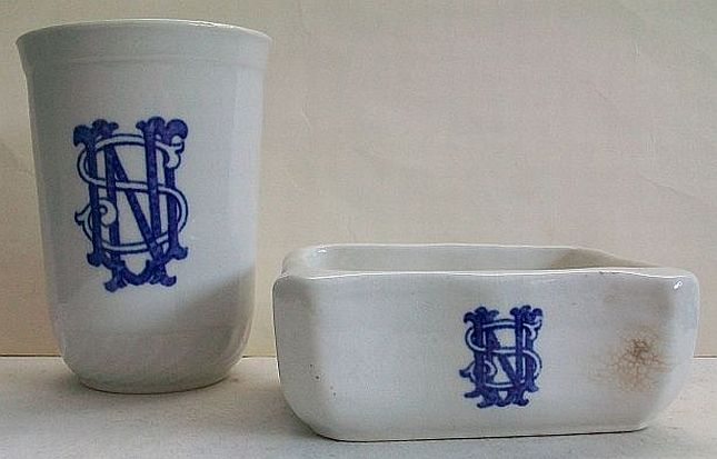 navy soap dish and water tumbler stamped with stylized USN