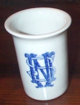 navy water tumbler stamped with stylistic USN monogram
