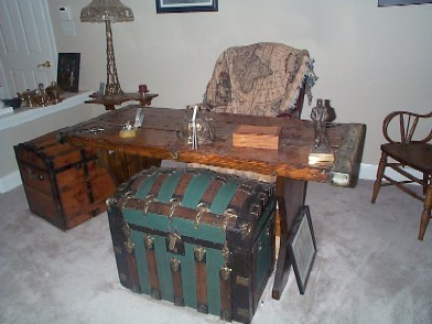 Nautical Themed Office with Nautical Desk and 2 Pirate Chests being used for file storage and desk accessories