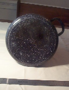 bottom view graniteware navy coffee pot showing stamped USN