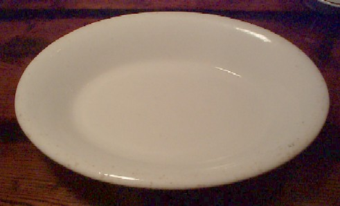 plain white large serving bowl dated 1909